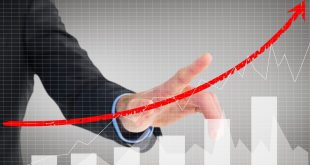 composite of businessman pointing at rising graph
